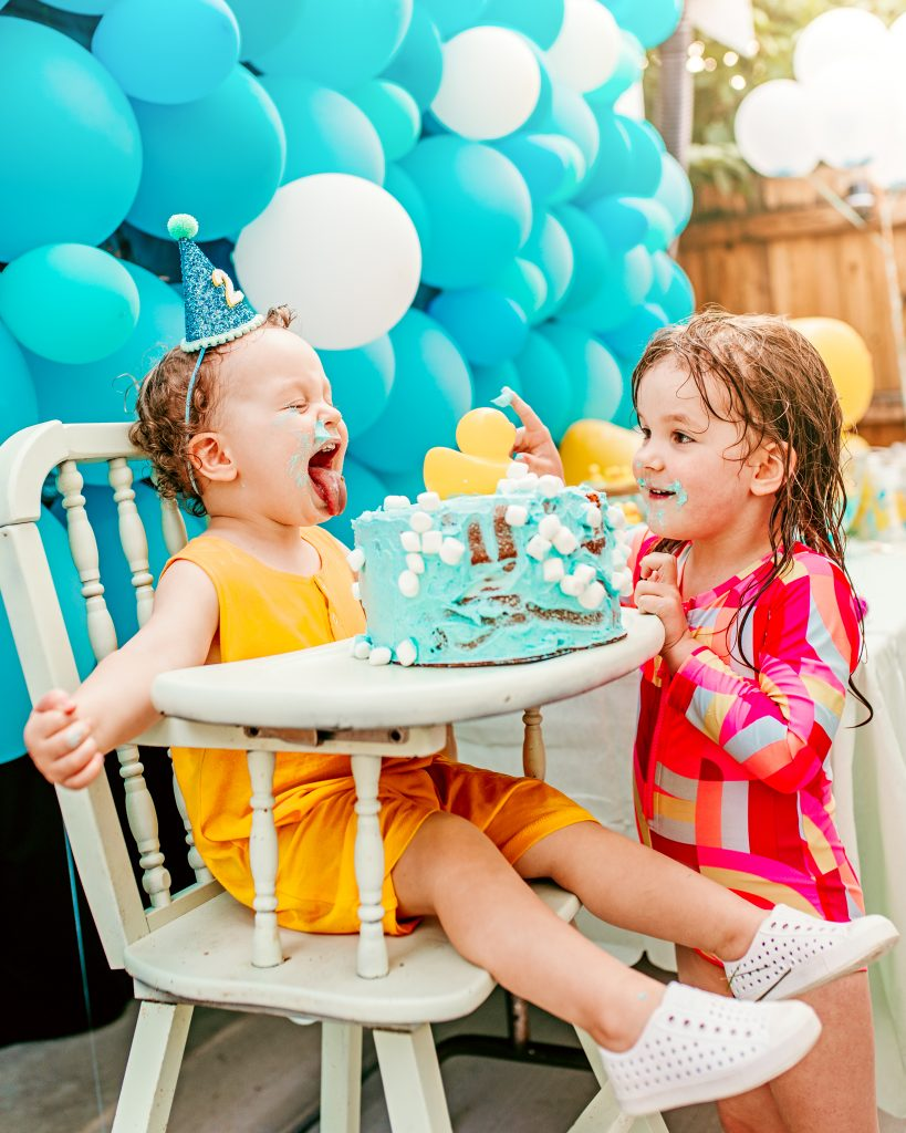 Brother and sister sharing cake. Birthday Party
