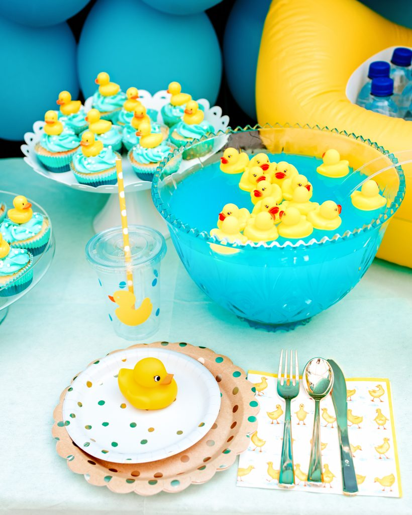 Rubber ducks floating in punch bowl and table settings