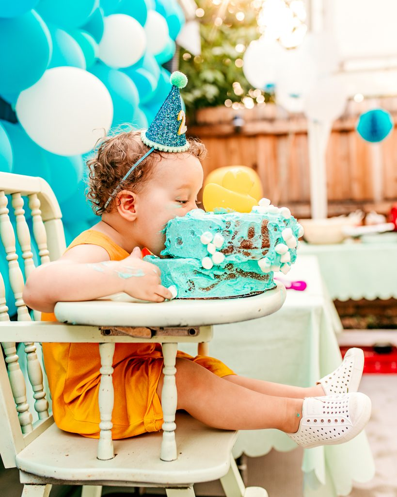 Two Year old eating Birthday Cake