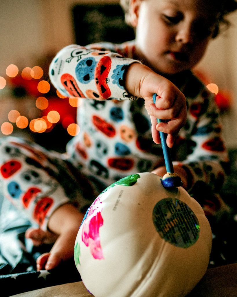 Painting pumpkins in pajamas!