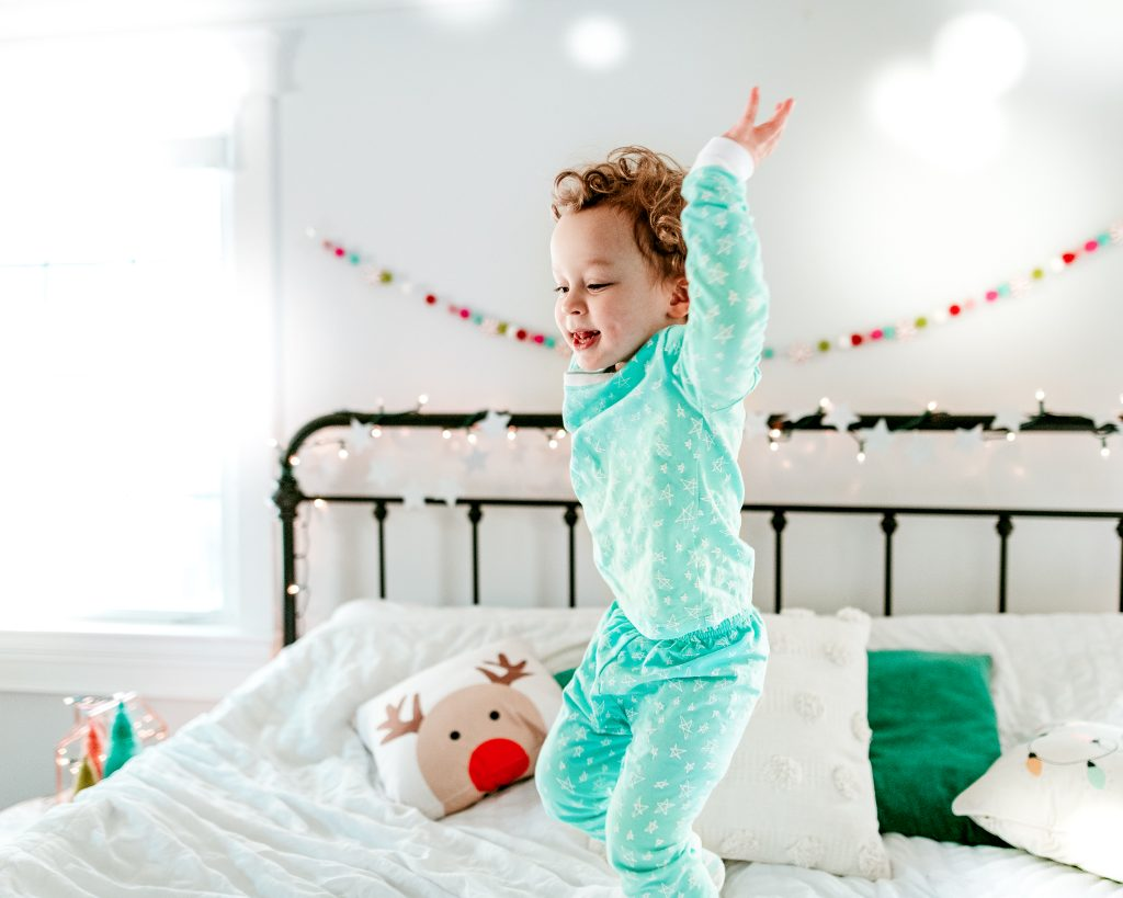 Jumping on bed in holiday jammies