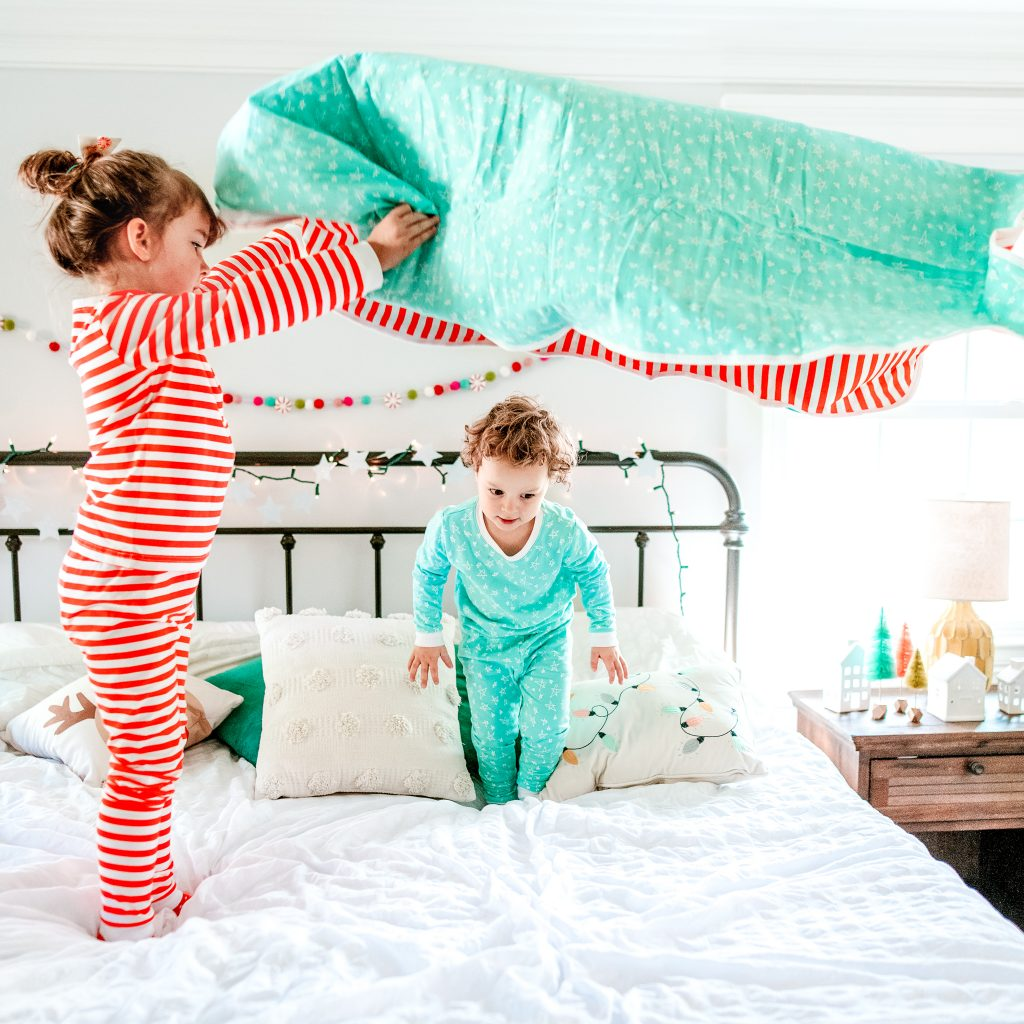 Children playing in holiday pajamas