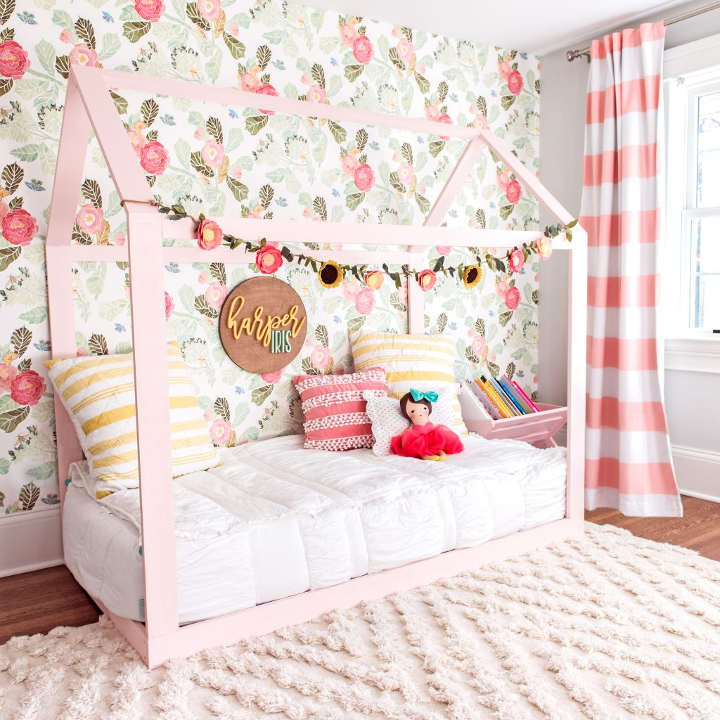 Bright and whimsical floral big girl bedroom ideas. Featuring a DIY housebed and lots of bright colors and textures! The sweetest details that will grow with my toddler girl!