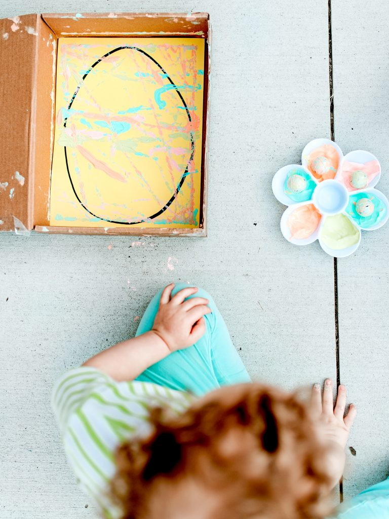 Make pretty Easter eggs by rolling painted marbles!