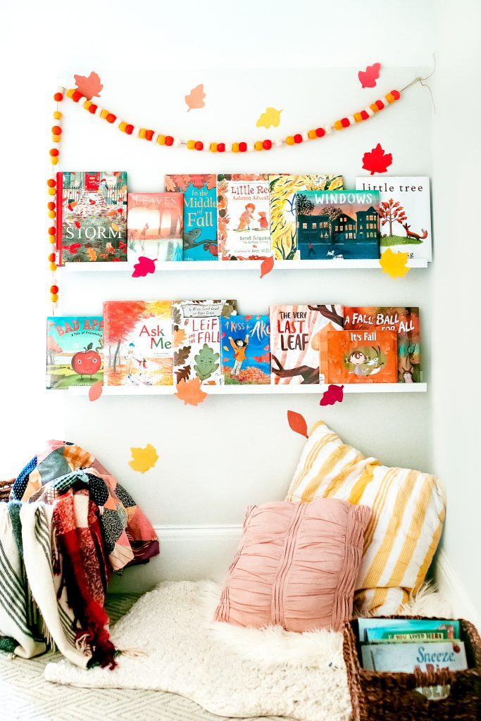 Creating a cozy autumn book corner with our favorite fall titles, soft blankets and pillows, and DIY decorations!