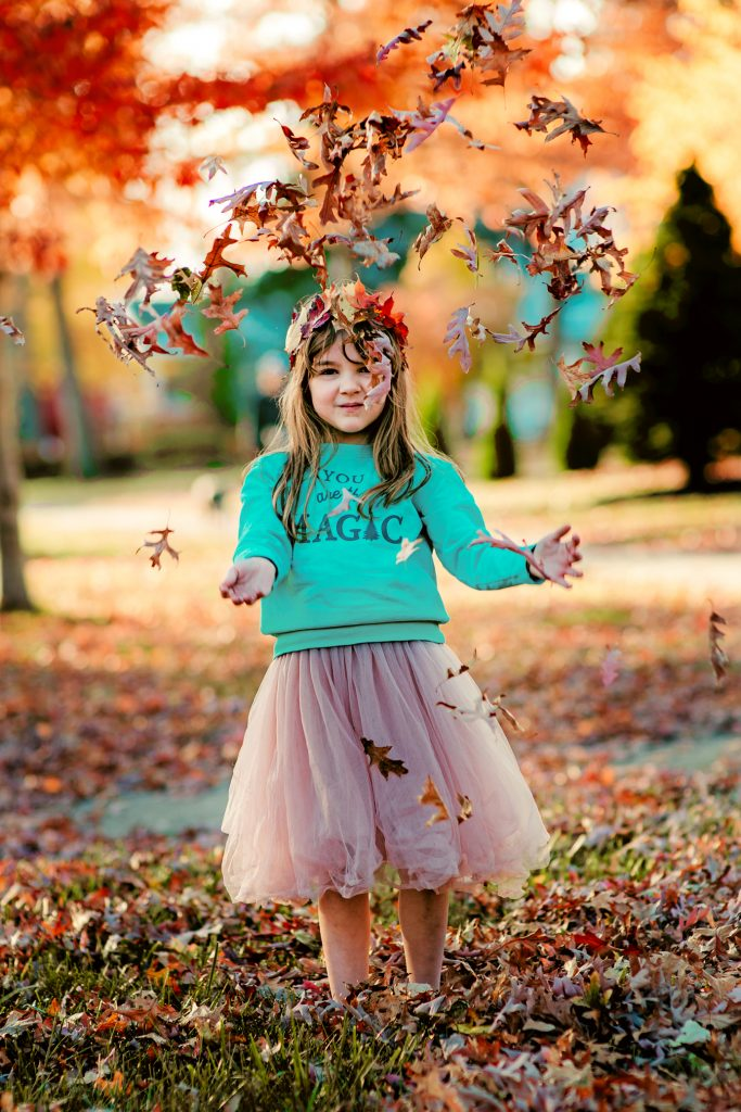 Fall Photography: Little Girl throwing Fall Leaves In the Air
