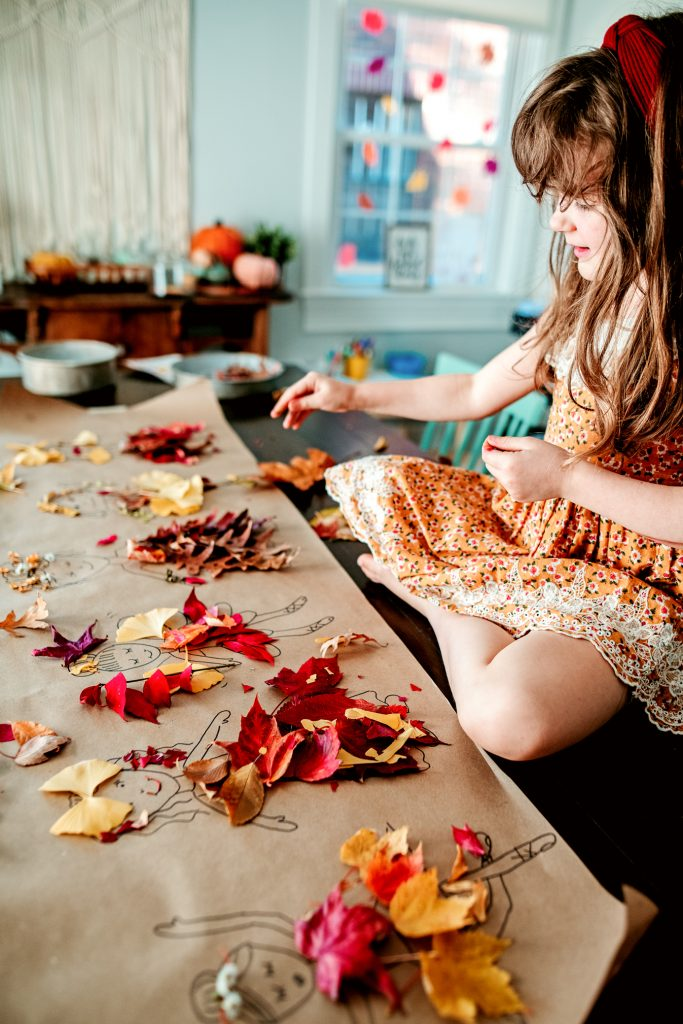 Use fall leaves to create a Paper Doll Craft for kids to dress and decorate their little leaf ladies!