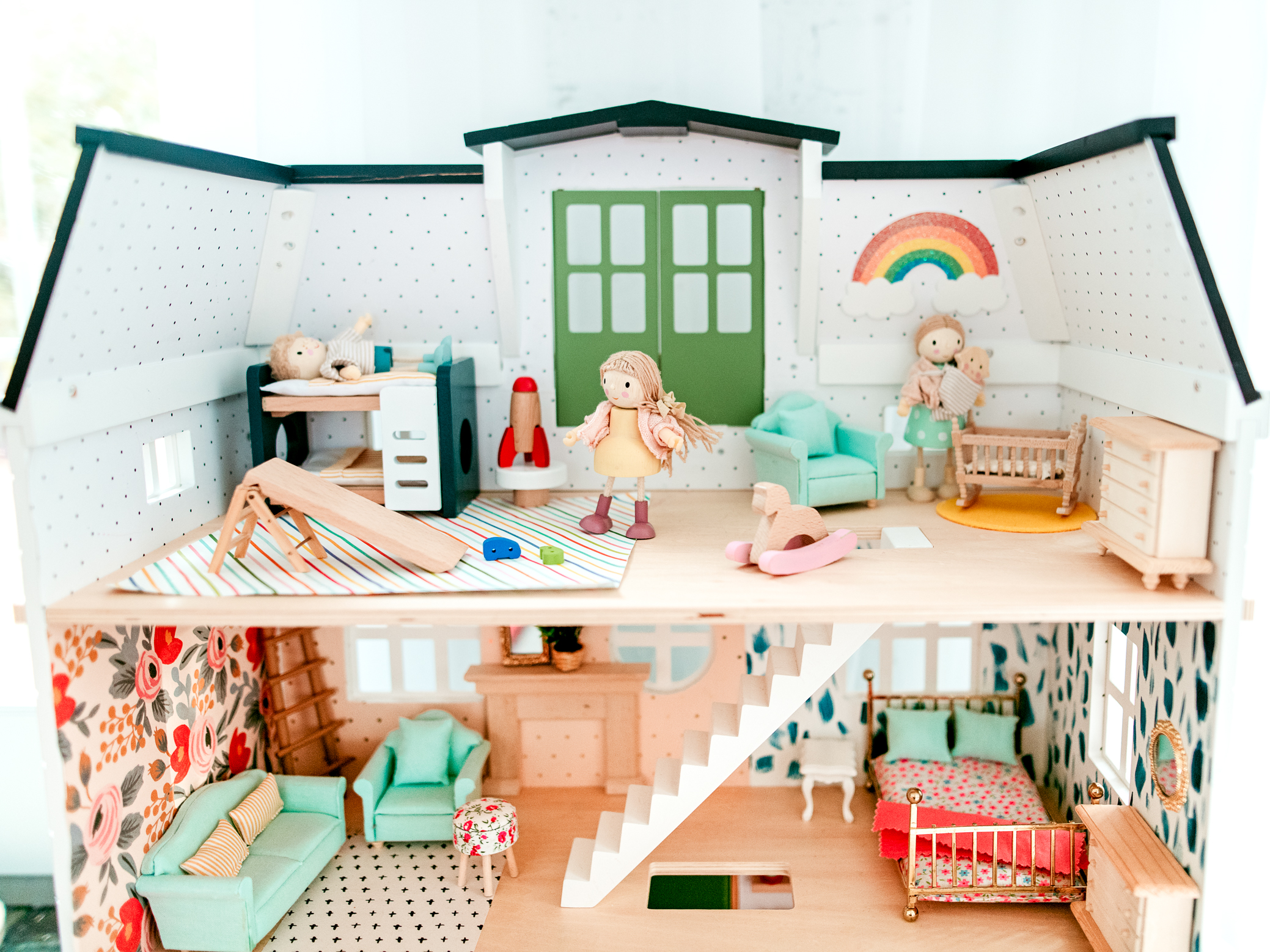 Hearth and Hand Dollhouse ; come see how I turned a plain dollhouse into a bright and colorful one of a kind piece!