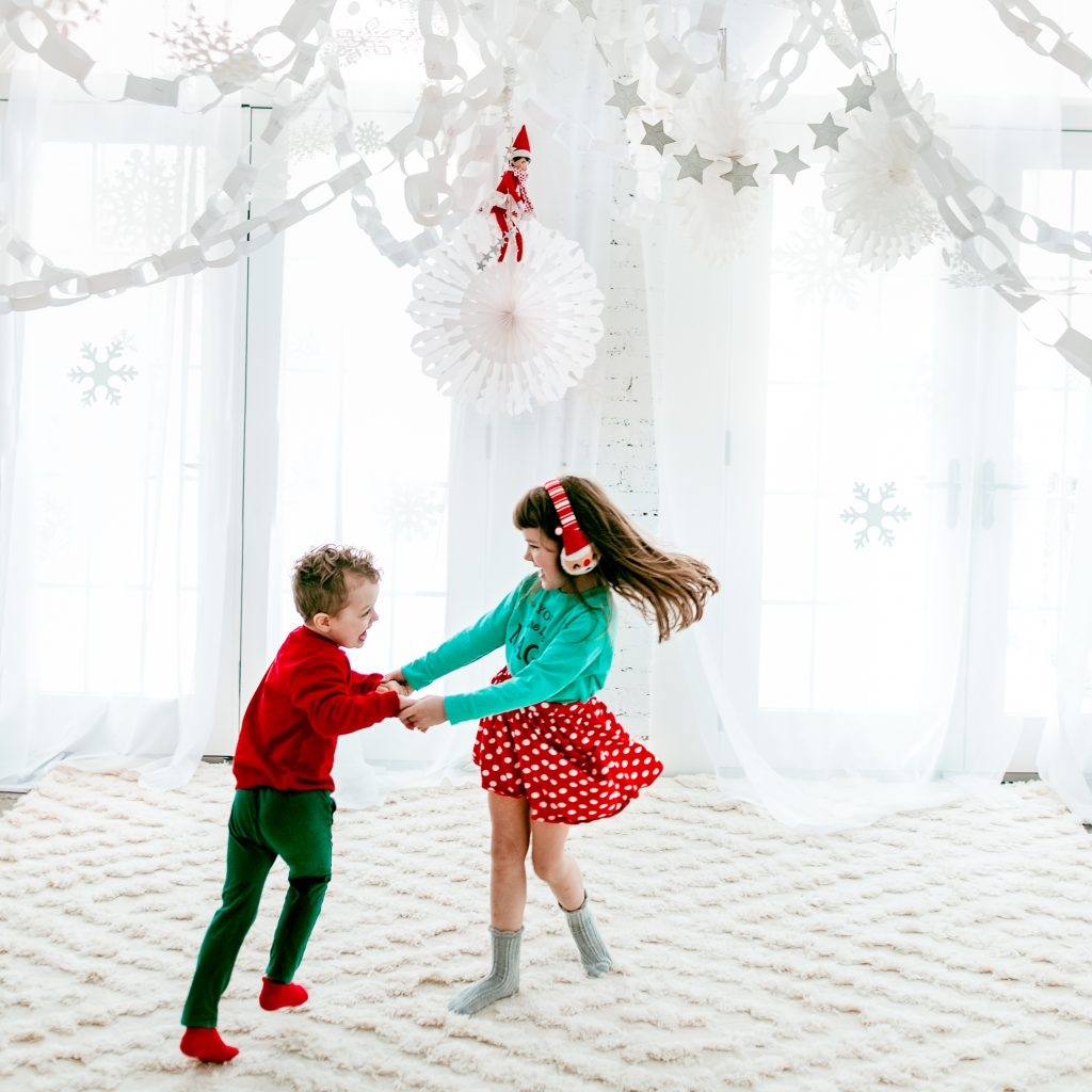 Dancing in a DIY winter wonderland! How to make your own snowflake ceiling for an indoor snow day!