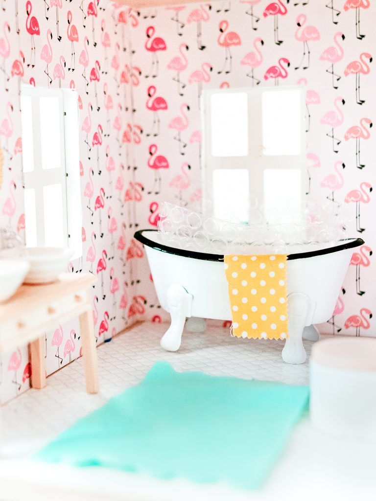 DIY Bright and Colorful dollhouse bathroom with flamingo wallpaper, double sink, and clawfoot tub