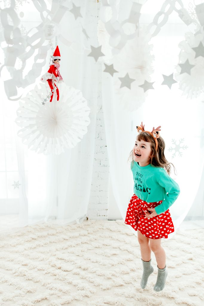 A stunning Elf on the Shelf arrival using paper chains to make a snowy indoor winter wonderland
