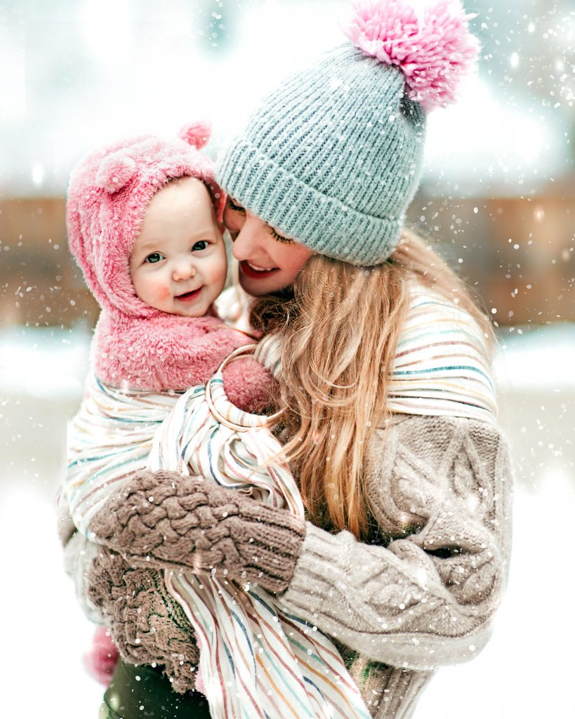 Mommy and me photo in the snow. Winter style for mommy and baby. Chunky knits, baby bear bunting, and bright colors.