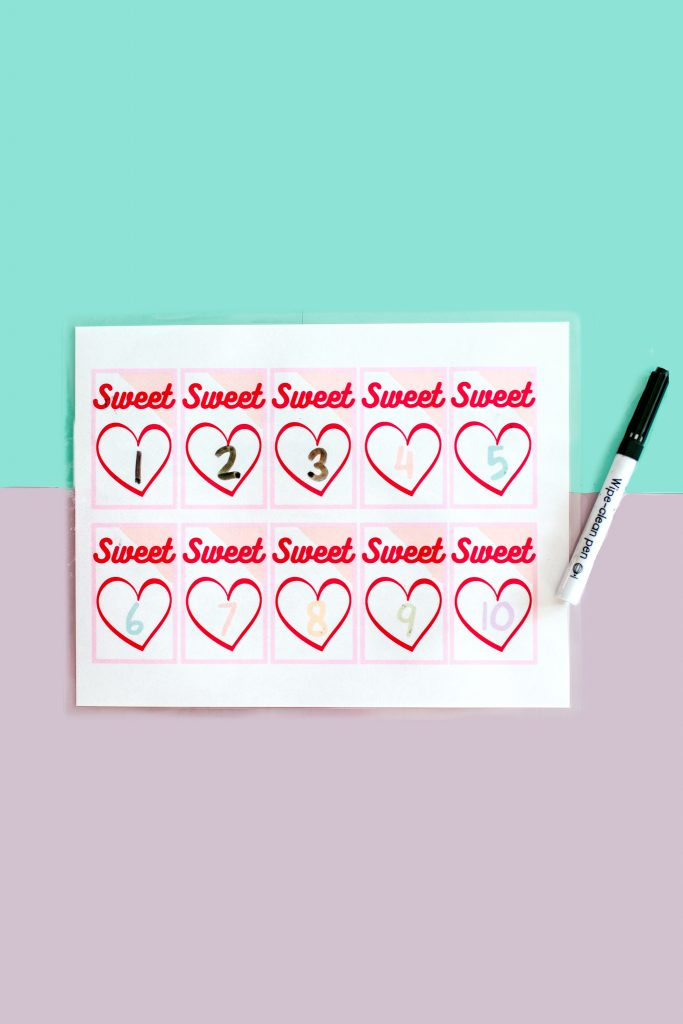 Laminate a worksheet to practice writing over and over again with a dry erase marker and more math activities for Valentine's Day!