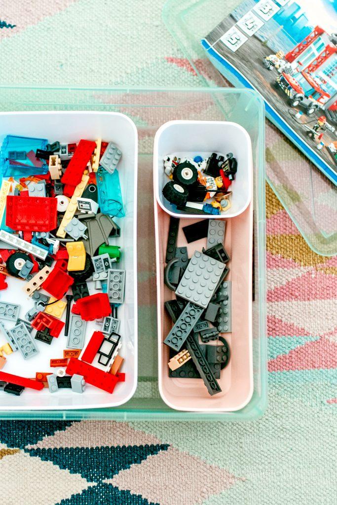 Legos sorted in a DIY storage bin