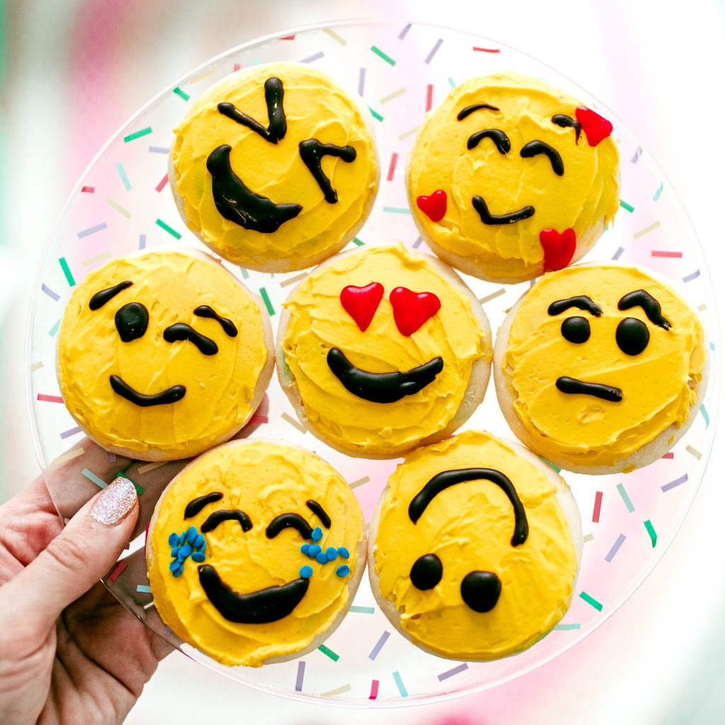 A plate full of Emoji Cookies decorated for World Emoji Day