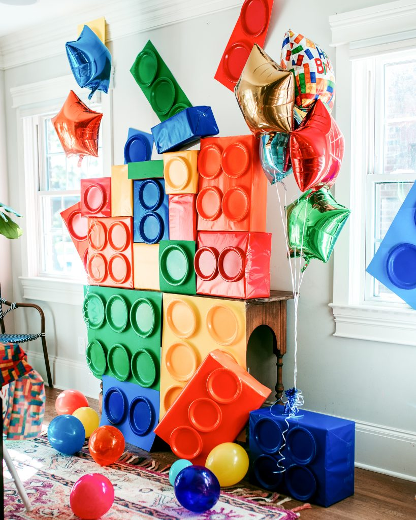 Lego birthday party DIY decorations! Use boxes, poster board, and paper plates to create giant legos!